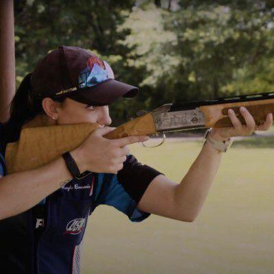 Kayle holding a shotgun