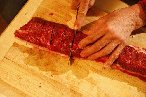cutting deer tenderloin into sections