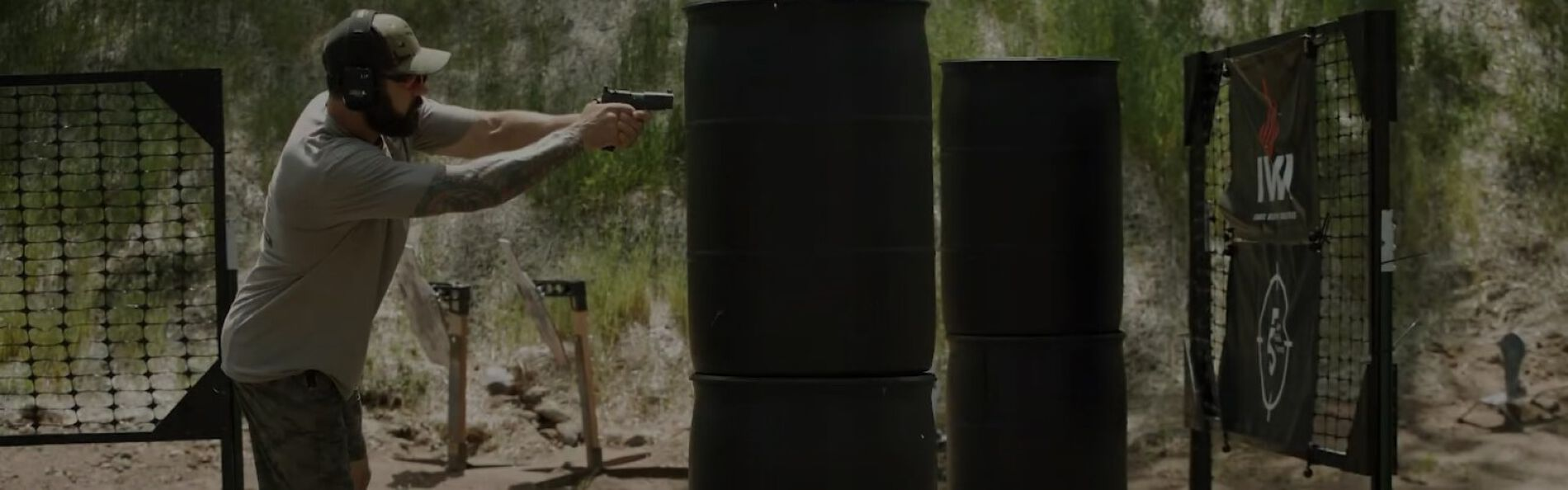 Josh Froelich shooting a pistal at an outdoor range