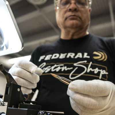 Custom Shop specialist inspecting Custom Rifle ammo