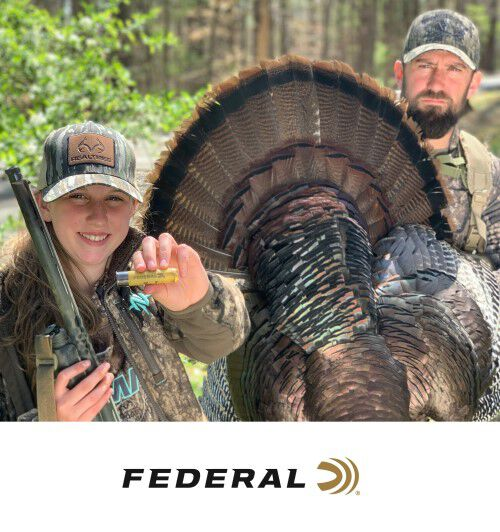 2 hunters showing off a tom and Federal ammunition