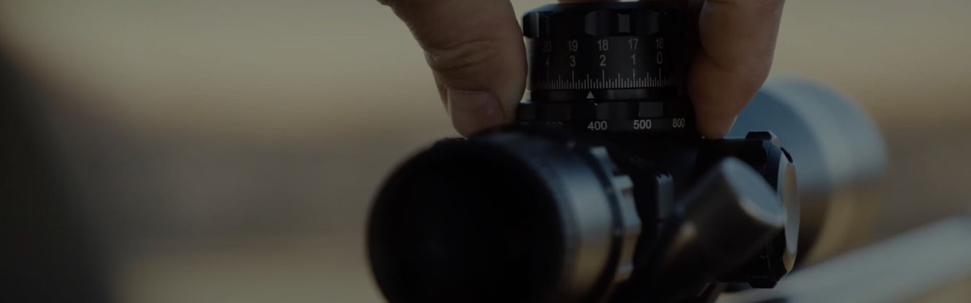 Range Dial being turned up on a rifle scope