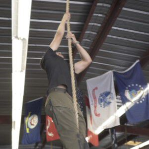 Dave Castro Climbing Up a Rope