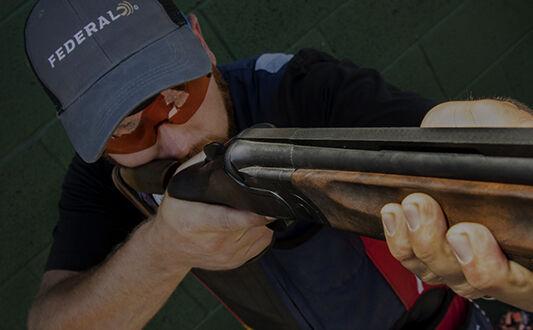 Vincent Hancock looking down a shotgun