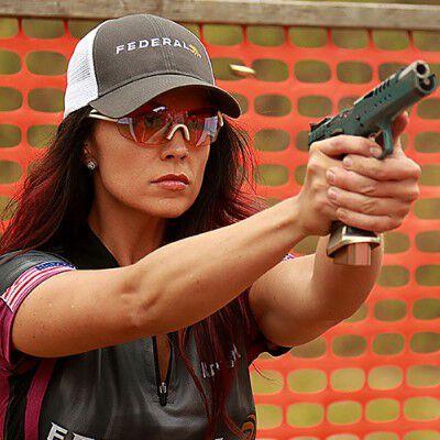 Krystal Dunn firing a handgun