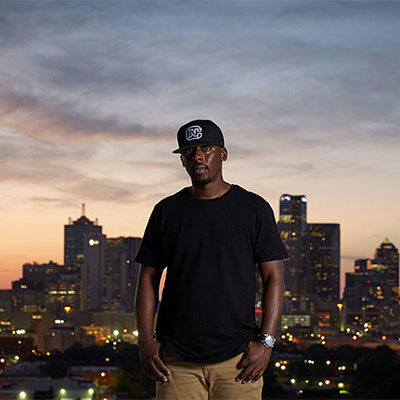 Colion Noir standing in front of city scape