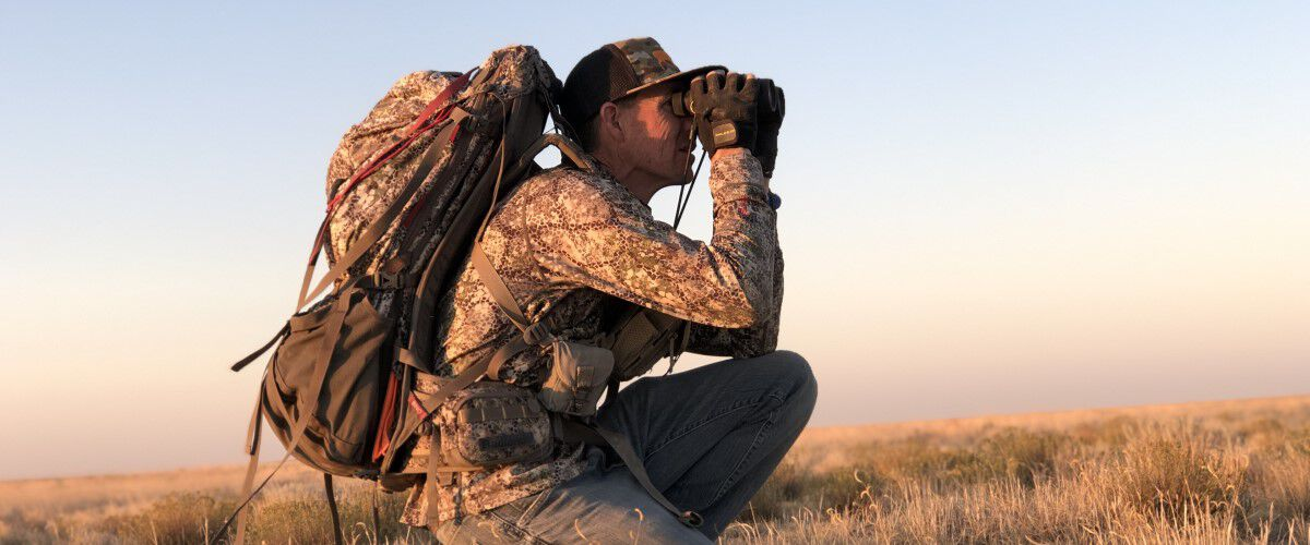 Hunter looking in binoculars