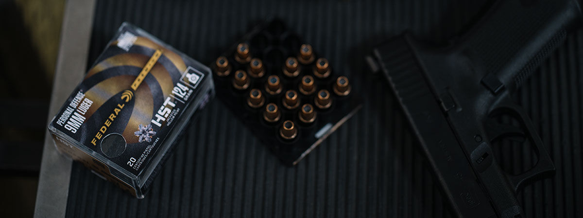 Person loading HST into Handgun