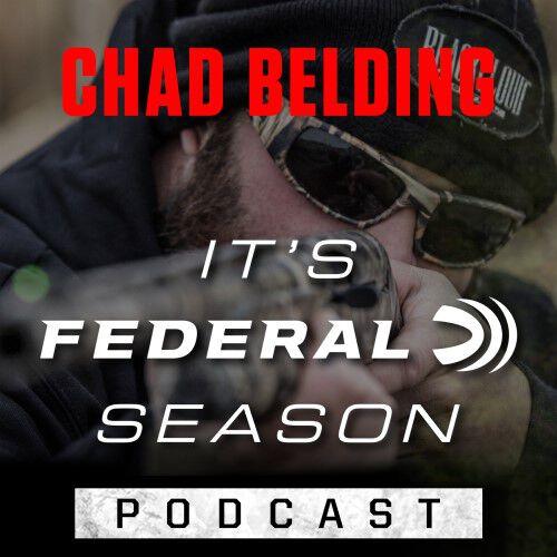 Chad Belding aiming a shotgun