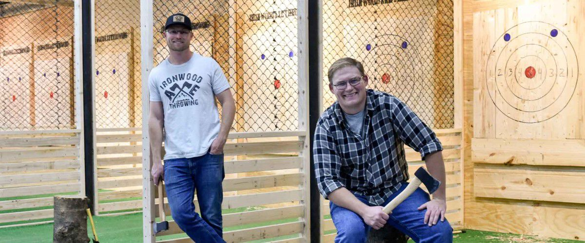 Brian and his brother Jon standing at Ironwood Axe Throwing