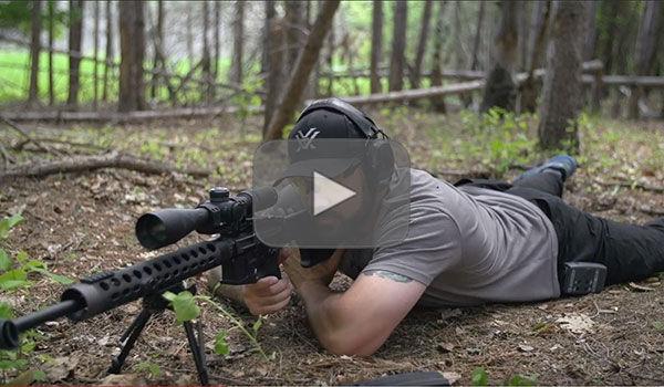 Josh Froelich is a prone position looking down scope
