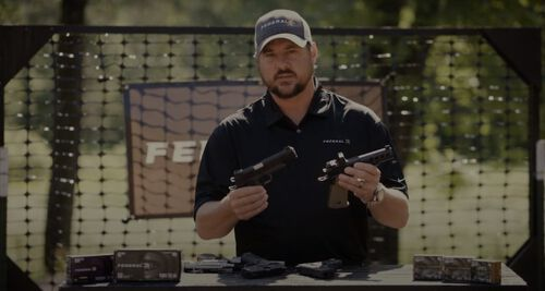 Jim Gilliland holding two pistols