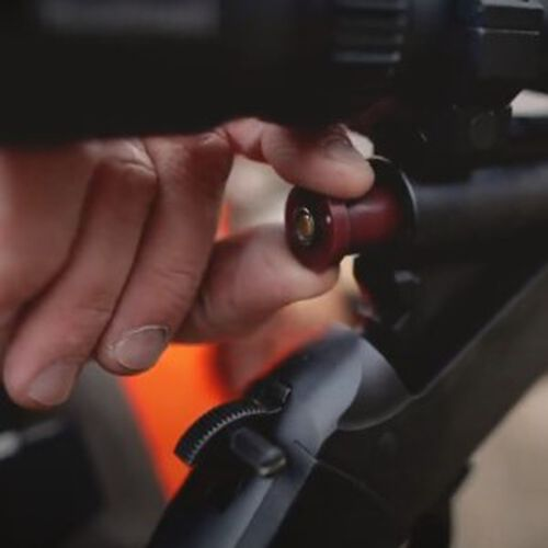 Firestick being loaded into a muzzleloader