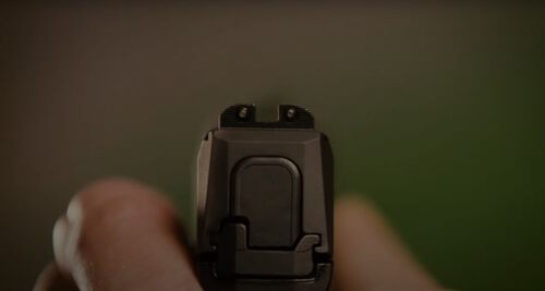 Looking down the iron sights of a handgun