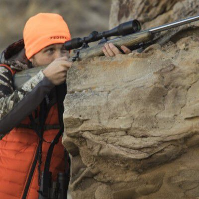 Shooting rifle off a rock