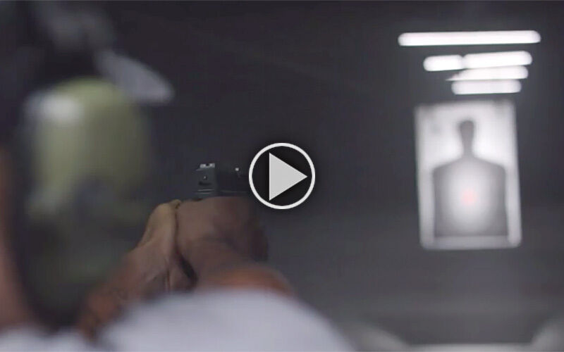 Shooter aimging at a target in an indoor range