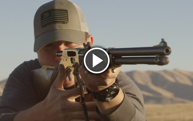 Man shooting lever action rifle