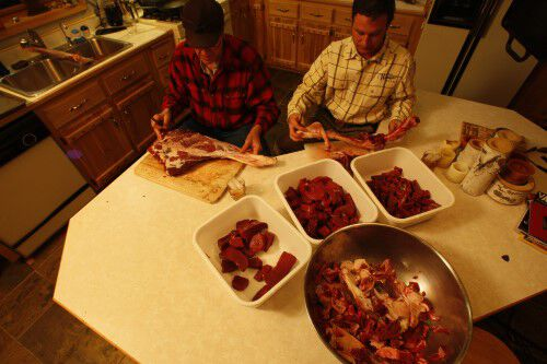deer meat in bowls on a table