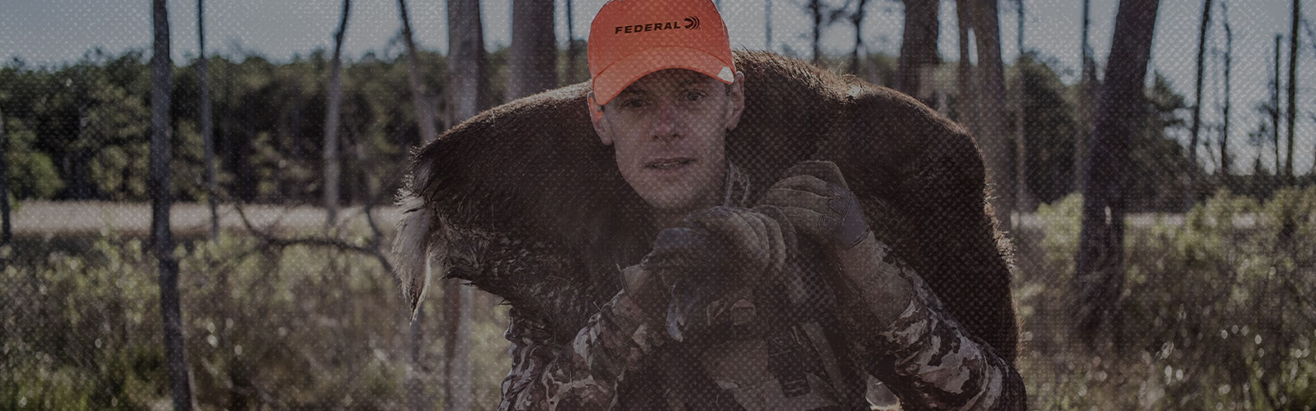 Steven Rinella carrying a turkey