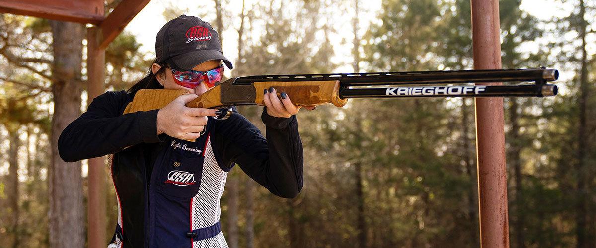 Kayle Browning shooting a shotgun