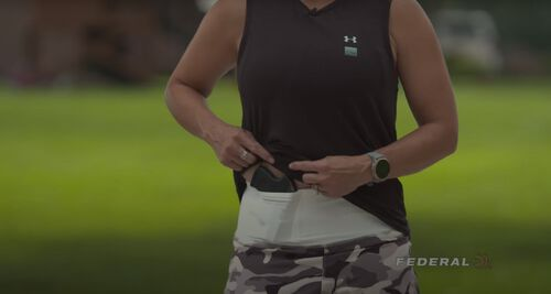 Tiffany showing where she carries her concealed handgun