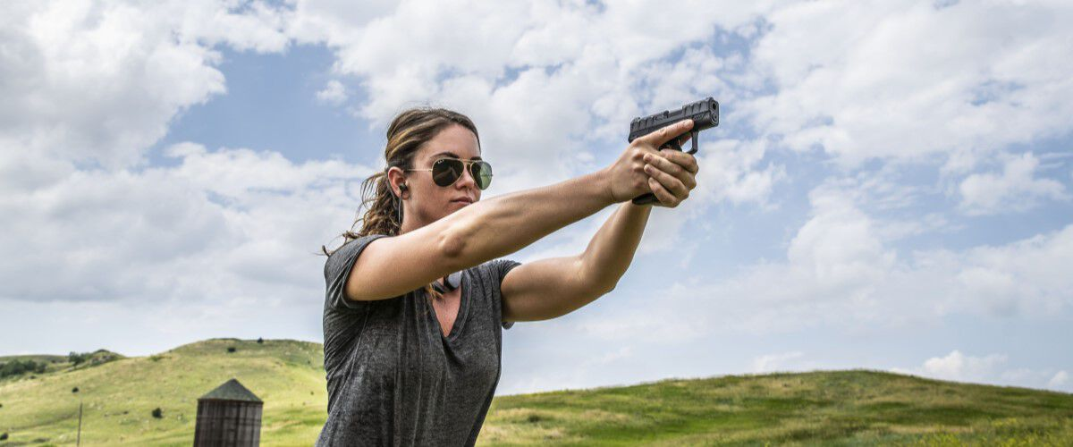 Sportswoman Courtney shooting a handgun