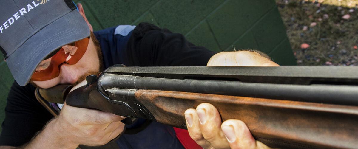 Vincent Hancock looking down the barrel of a shotgun