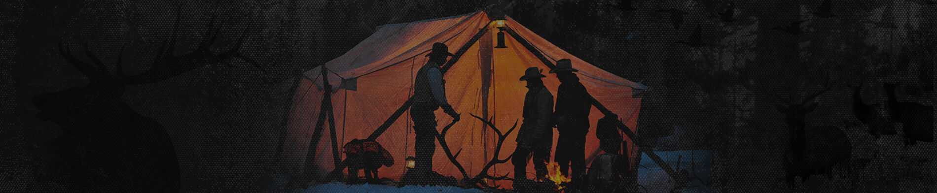 hunters backlit in front of a tent