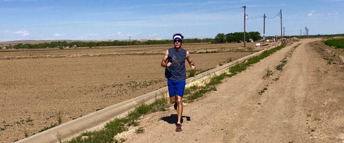 Man running down a dirt road
