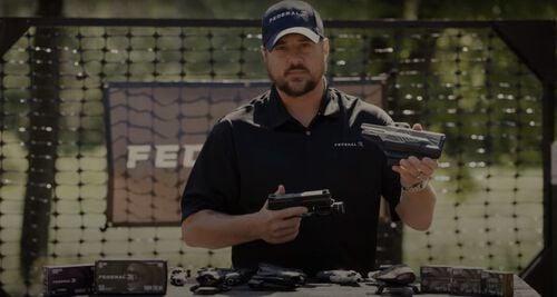 Jim Gilliland holding a pistol holster outside