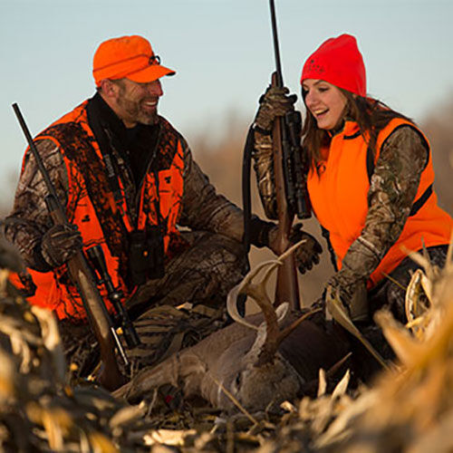 Man and Woman Deer Hunting