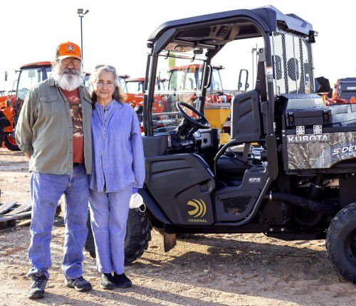 Chon Martinez of Anderson, Texas, and his wife, Mary, stand in front of a Federal-branded Kubota Sidekick utility vehicle he won through the 2020 Federal Kubota Sweepstakes.
