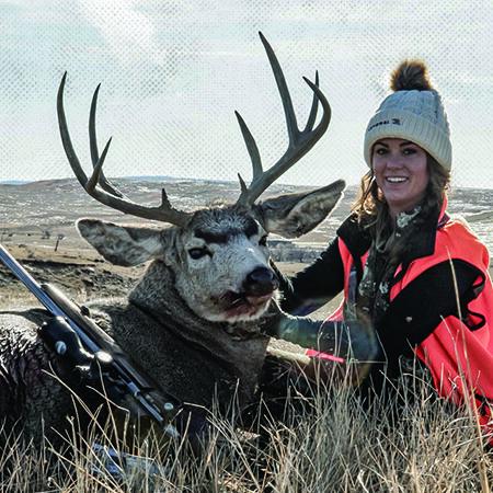 Sportswoman Courtney with buck