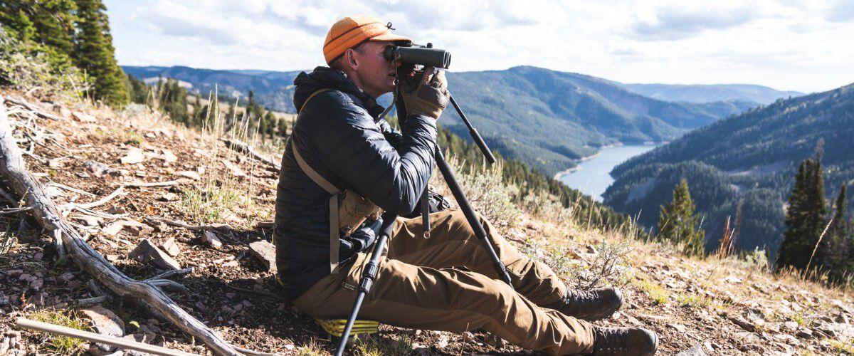 Janis Putelis looking through binoculars