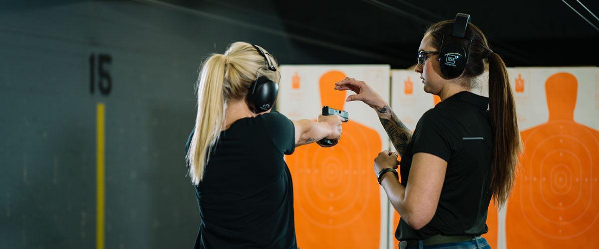 Two Women at an Indoor Gun Range