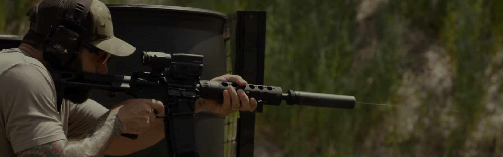 Josh Froelich Shooing a rifle at an outdoor range